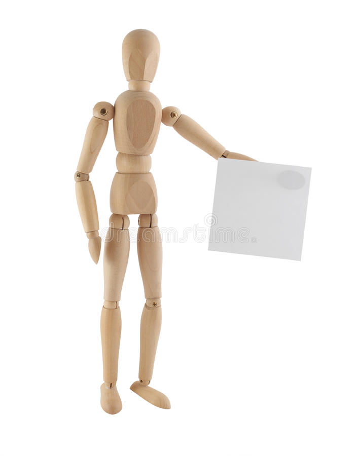 Wooden model holding blank sheet royalty free stock photo