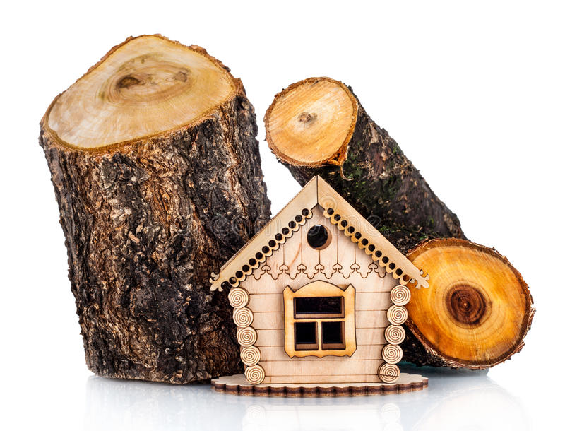 Wooden model of house and stack of wood stock photography