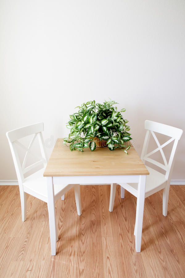 Wooden modern dinning room table and chairs royalty free stock photos