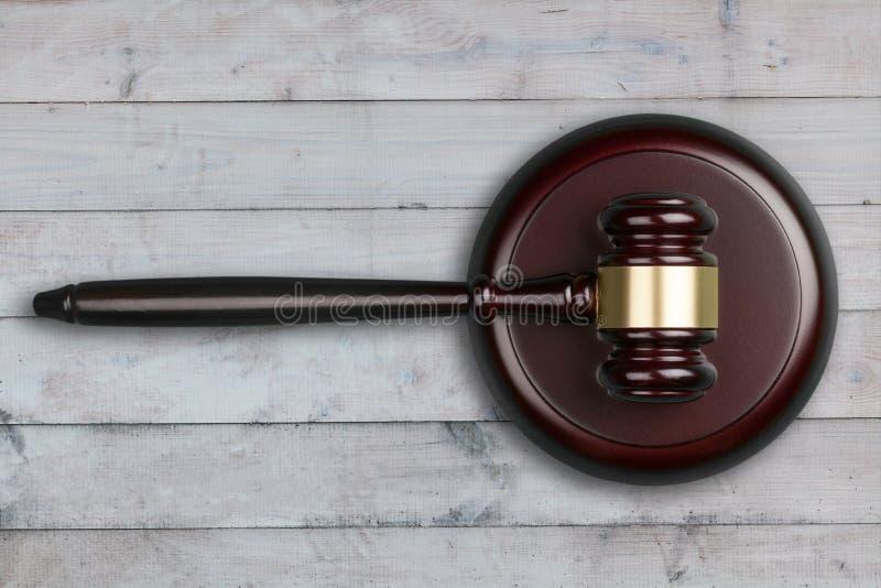 Wooden modern justice gavel on wooden desk stock photo