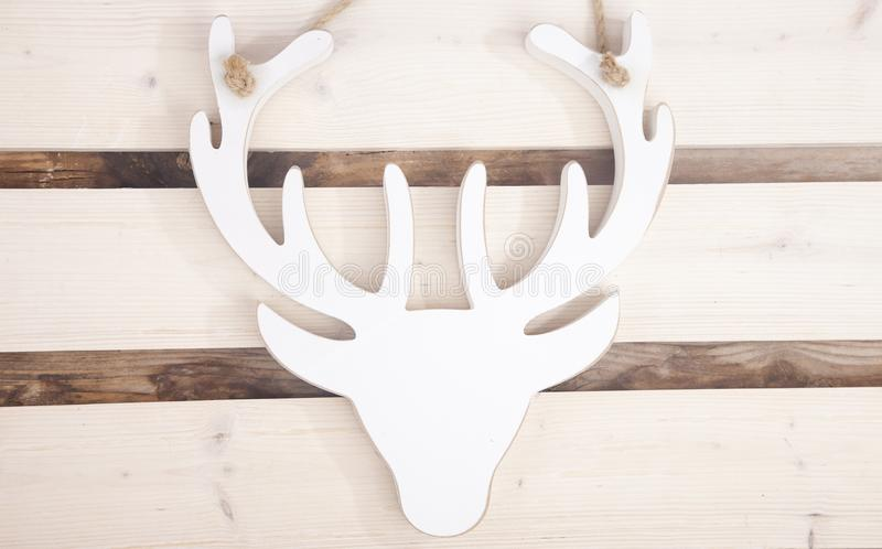 Wooden moose head on wooden background royalty free stock images