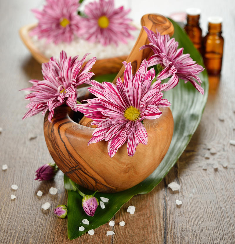 Wooden mortar and flowers stock photo