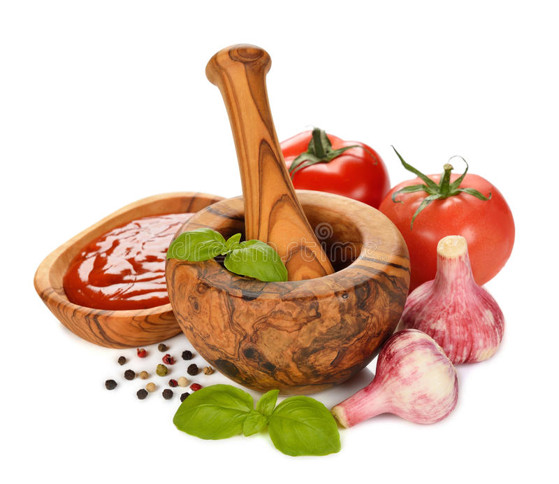 Wooden mortar, vegetables and spices stock photos