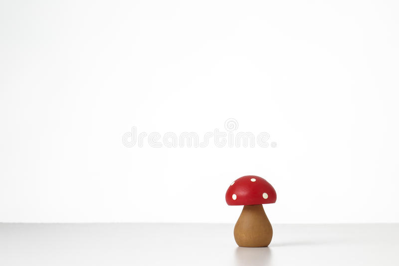 Wooden mushrooms toy. Still life image of wooden mushrooms on white stock image