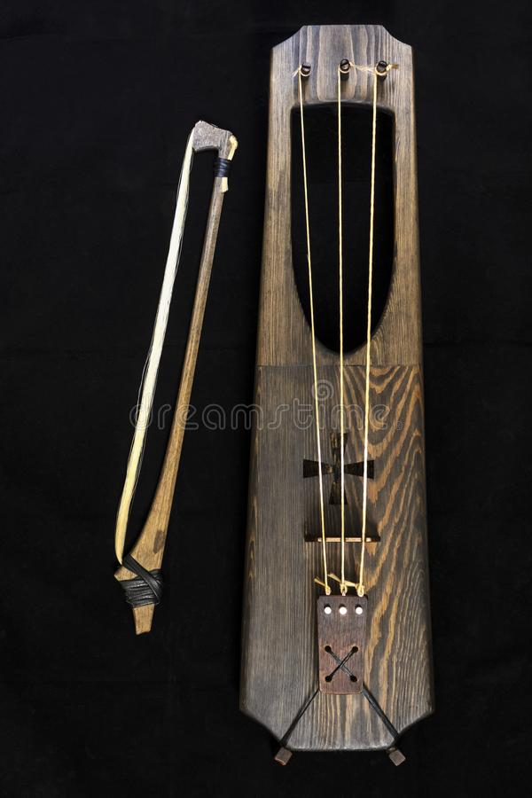 Wooden musical bowed harp instrument of talharpa. The talharpa, also known as a tagelharpa tail-hair harp or the strakharpa bowed harp, is a bowed lyre from stock photo