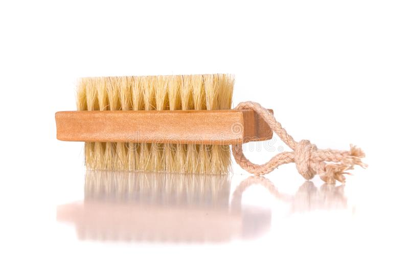 Wooden nailbrush. On white background closeup photo royalty free stock images