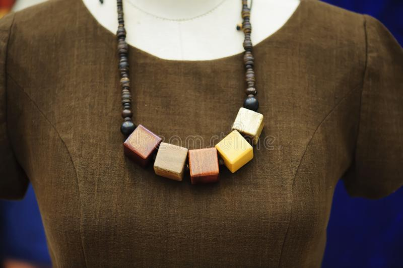 Wooden necklace - soft focus with vintage style royalty free stock image