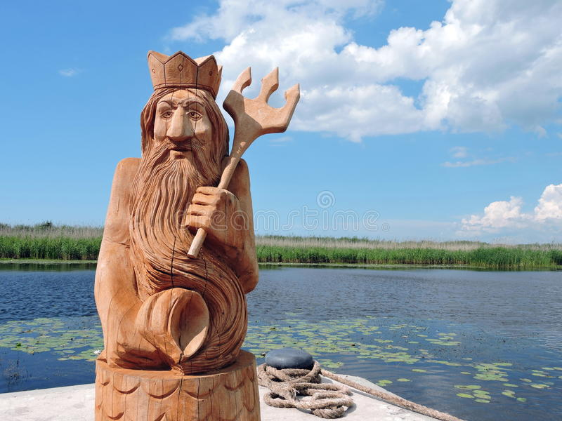Wooden Neptune statue royalty free stock photography