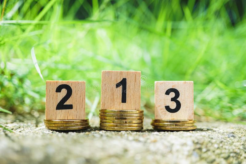 Wooden number on golden stack coins with green nature background. Using as business competition and financial concept, achievement, award, banking, best, cash stock photos