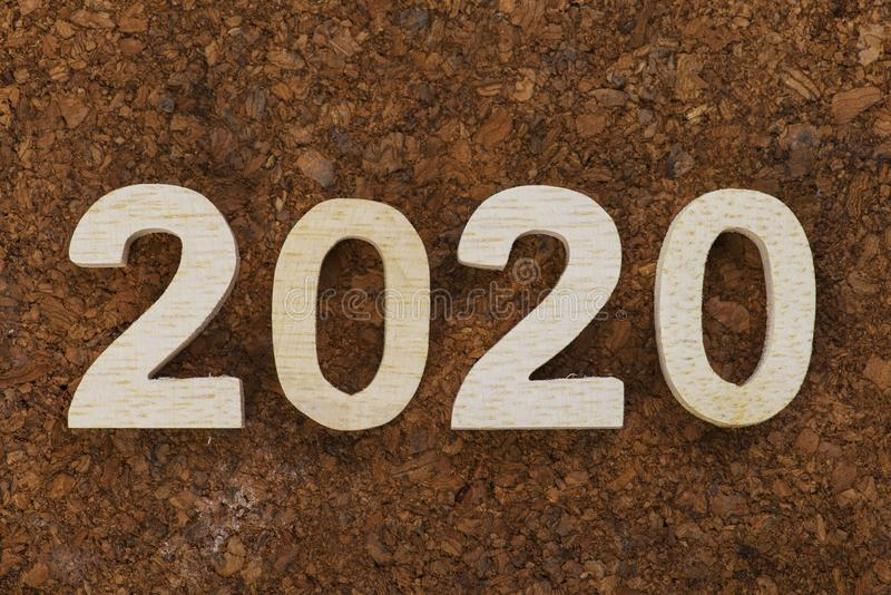 Wooden number of 2020 on wood abstract texture background stock images