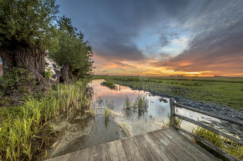 Wooden Observation Platform overlooking dutch countryside. During dark sky sunset royalty free stock images