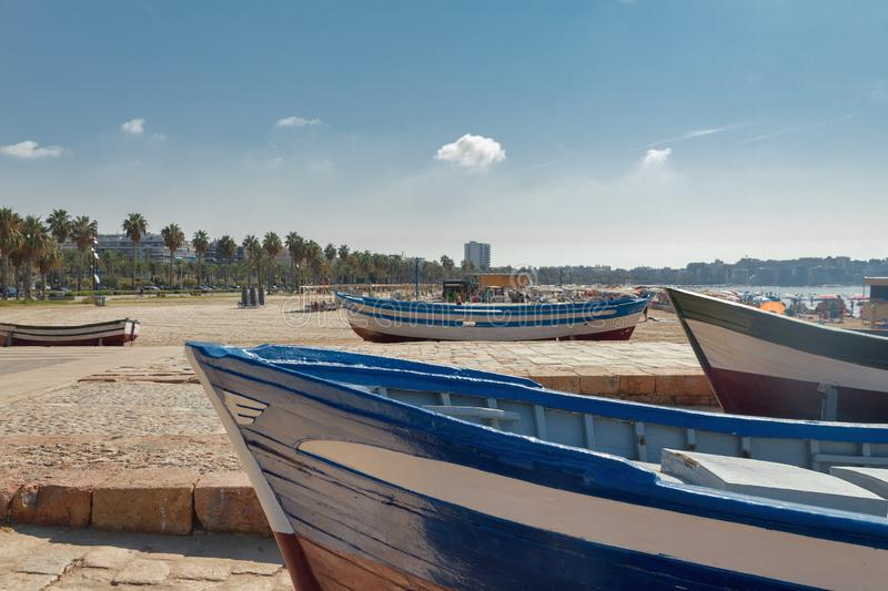 Wooden old blue and white boats on the Mediterranean coast in Spain, Salou beach stock photo