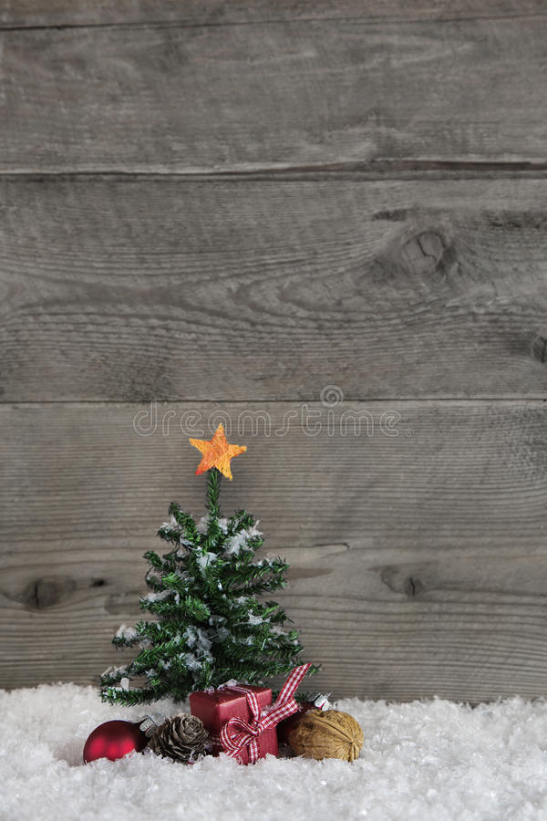 Wooden old country style background with a green christmas tree stock photo