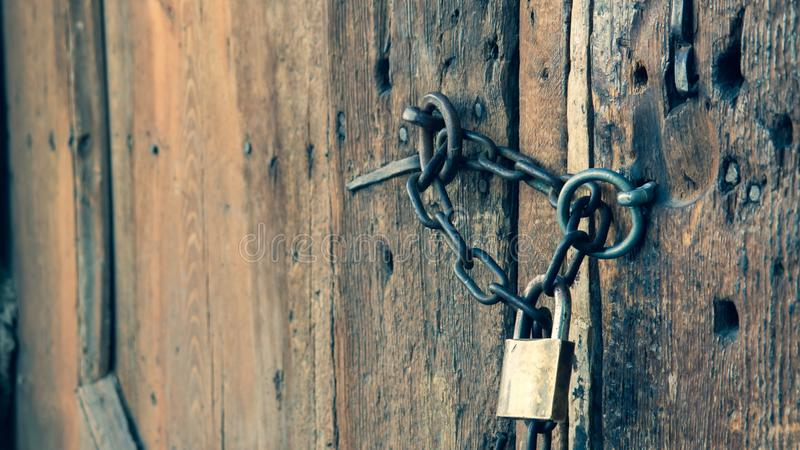 Wooden old house door and padlock on royalty free stock images