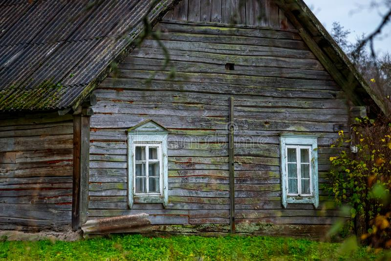 Wooden old house. In bare forest, late fall nature stock photos