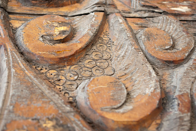 Wooden ornament with swirls. Old cracked pattern with peeling paint on the old wood royalty free stock photo
