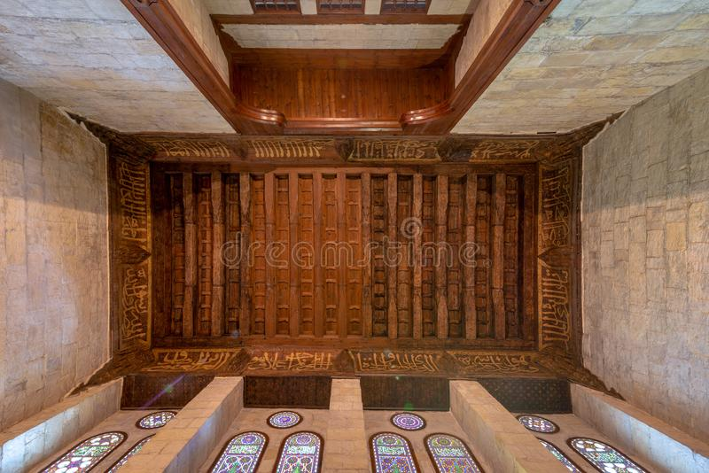 Wooden ornate ceiling with floral pattern decorations and colorful stained glass windows at al Ghuri Mausoleum, Cairo, Egyp stock photography