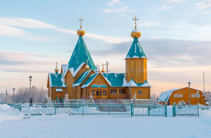 Wooden Orthodox church in the north of Russia in the winter. stock image