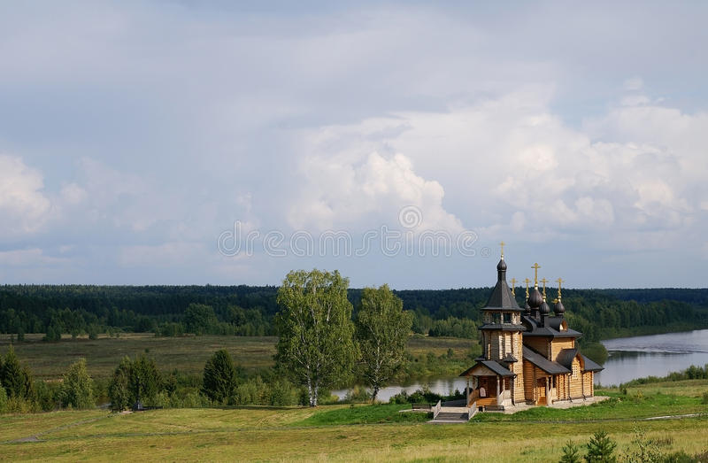 Wooden Orthodox Church On A River Bank Stock Photos