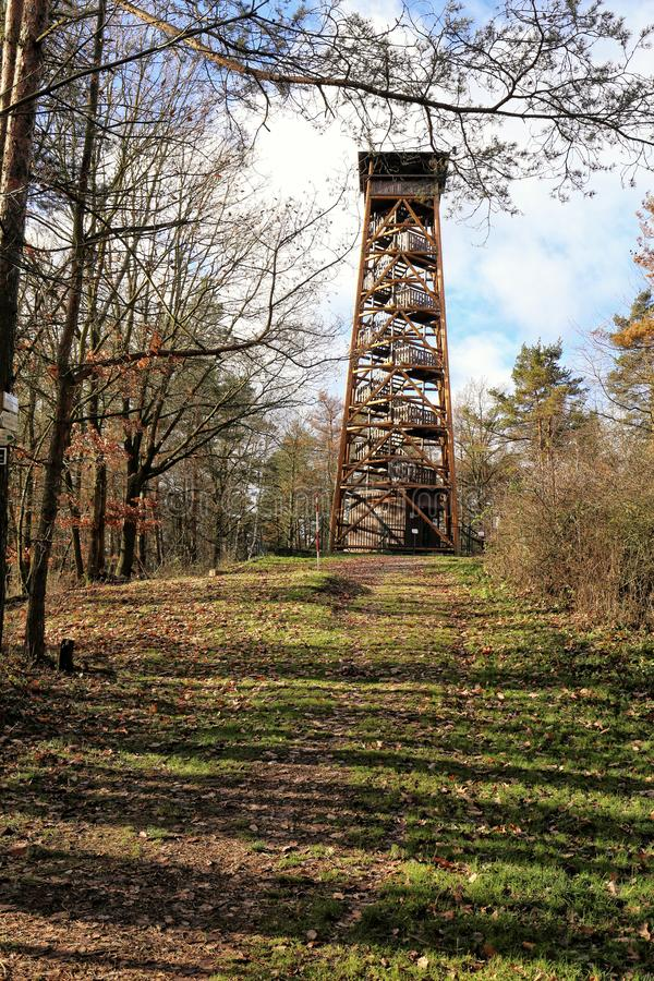 Wooden outlook tower on the top of the grassy hill. In autumn royalty free stock photo