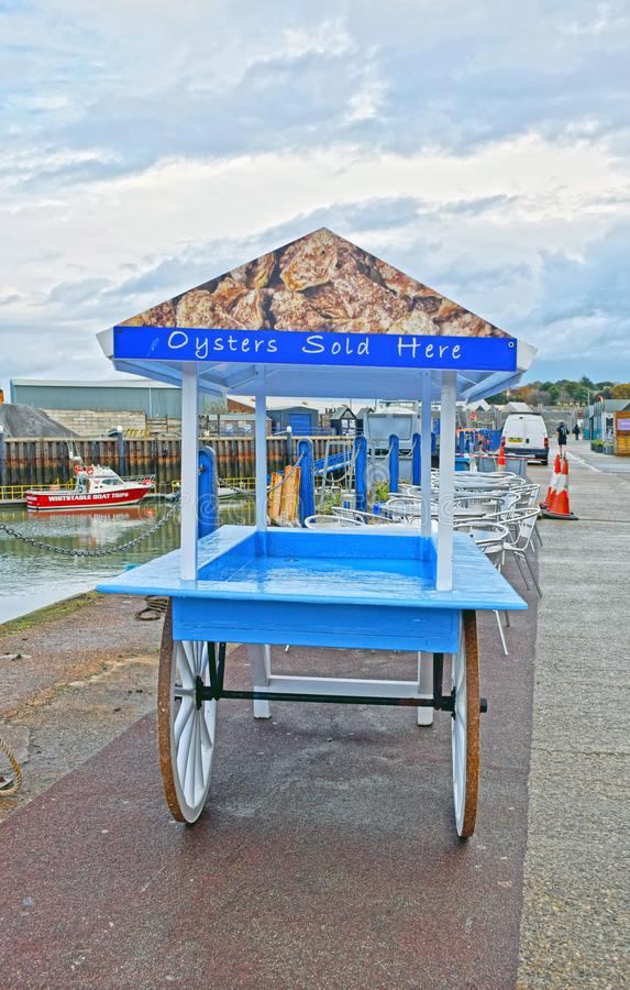 A traditional oyster cart. A wooden oyster cart that is used to push around by people to sell fresh oyster that they have caught in the Kent town of Whitstable royalty free stock photo