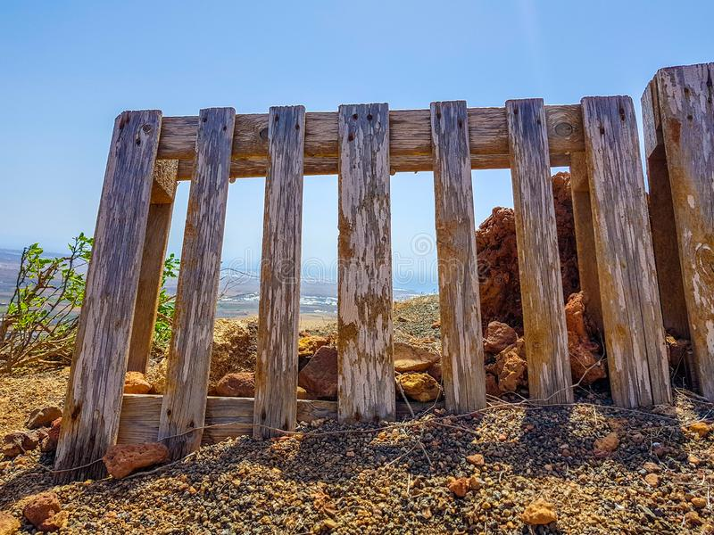 Wooden pallet making of separation fence in the earth field royalty free stock photo