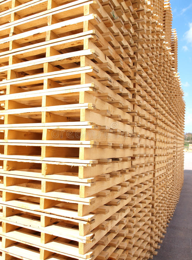 Wooden pallets. New wooden pallets in a factory, Italy royalty free stock photo