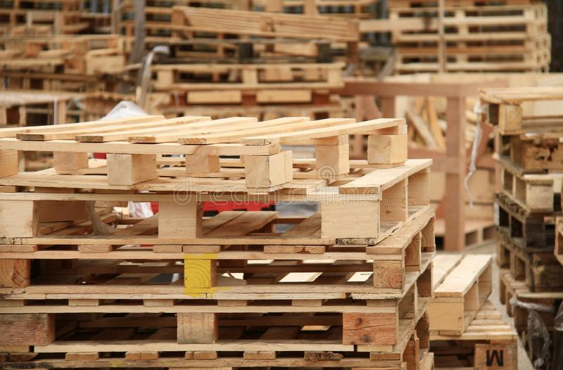 Wooden pallets. Image of wooden pallets stacked up behind a store royalty free stock photo