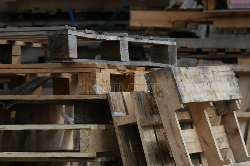 Wooden Pallets. Stacked up behind a store royalty free stock photos