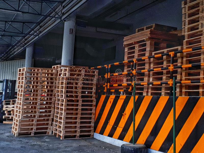 Wooden pallets. Pallets are the industrial stacking platform in the warehouse management system stock photos