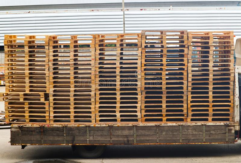 Wooden pallets stack on the truck at the freight cargo warehouse for transportation and logistics industrial royalty free stock photos