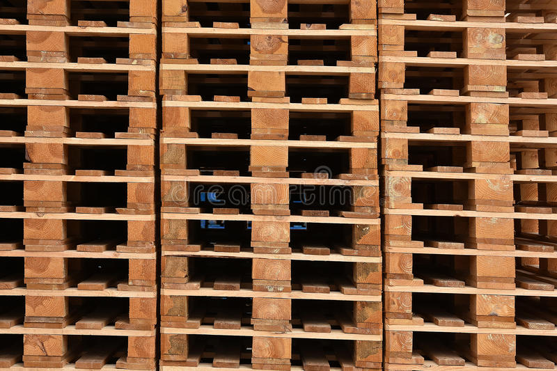 Wooden pallets. Stacks of wooden cargo shipping pallets stock photo