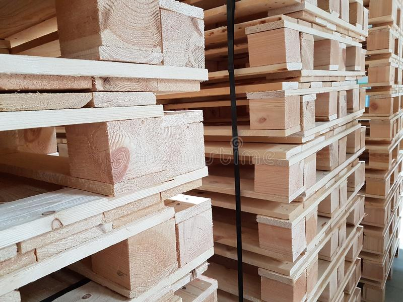 Wooden pallets storage industry transportation. Logictic cargo light brown royalty free stock photo