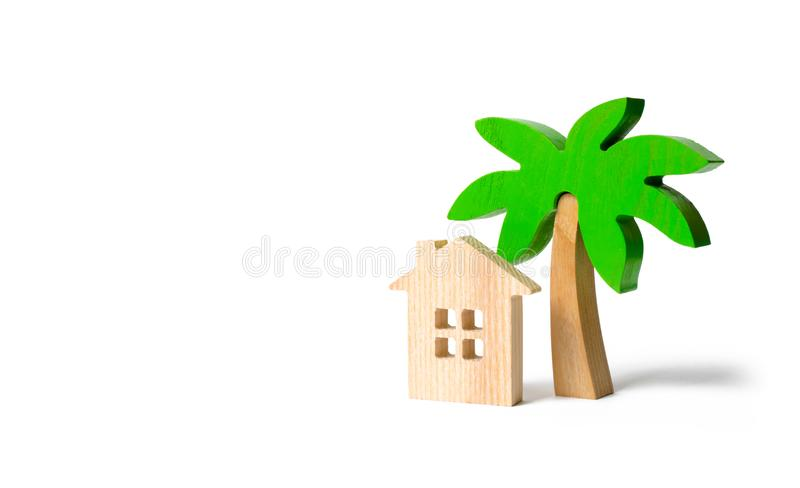 Wooden palm tree and hut on an isolated background. Conceptual leisure and vacation. Rental homes and properties in the resort royalty free stock photos