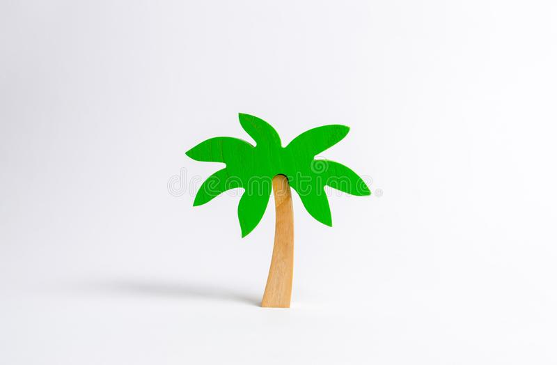 Wooden palm tree on a white background. Tours and cruises to warm countries. The development of tourism. Tropical island. royalty free stock photo
