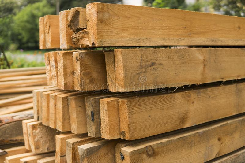 Wooden panels stored outside an industrial warehouse on metal shelving for use in construction and building. royalty free stock images