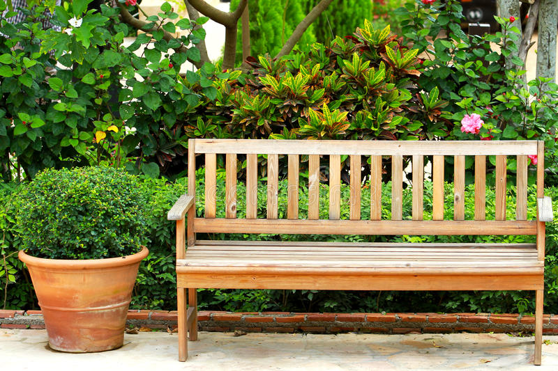 Wooden park bench. In the garden royalty free stock photography