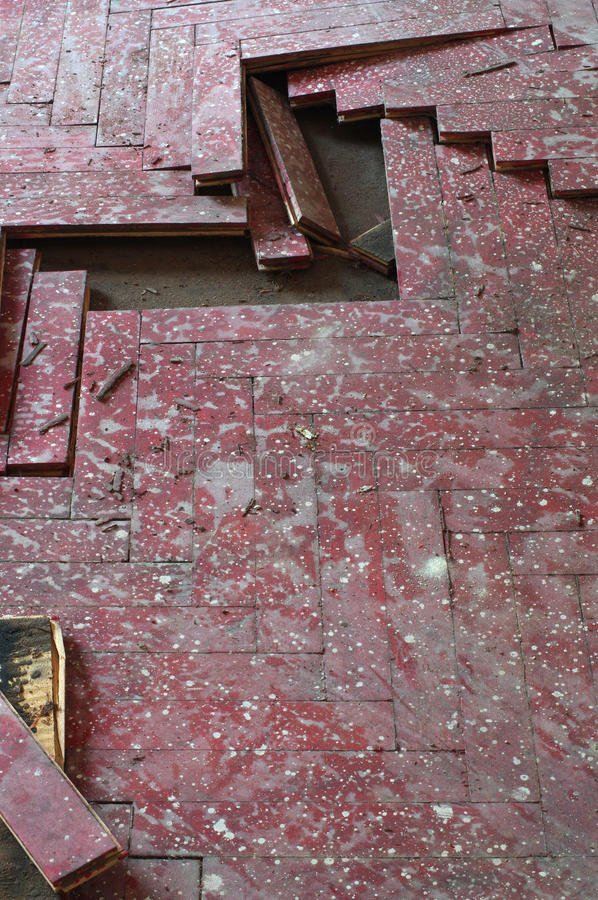 Wooden parquet floor red damaged. Detail defect royalty free stock photo