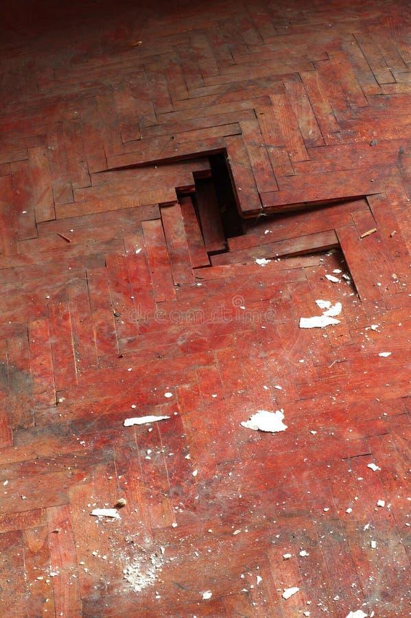 Wooden parquet floor red detail defect stock photos