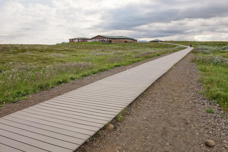 The wooden path leading to Gullfoss waterfall in iceland with a cafe building in background royalty free stock photos