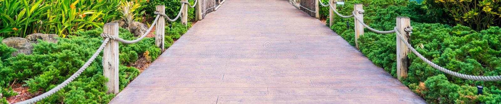 Wooden path in a park in spring royalty free stock photography