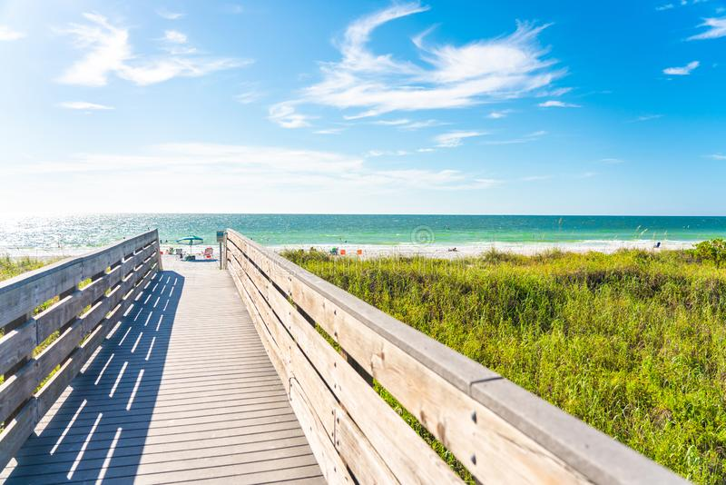 Wooden Boardwalk to Indian rocks beach in Florida, USA. Wooden path to Indian rocks beach in Florida, USA stock photo