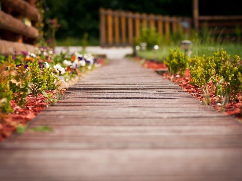 Wooden pathway through garden stock images