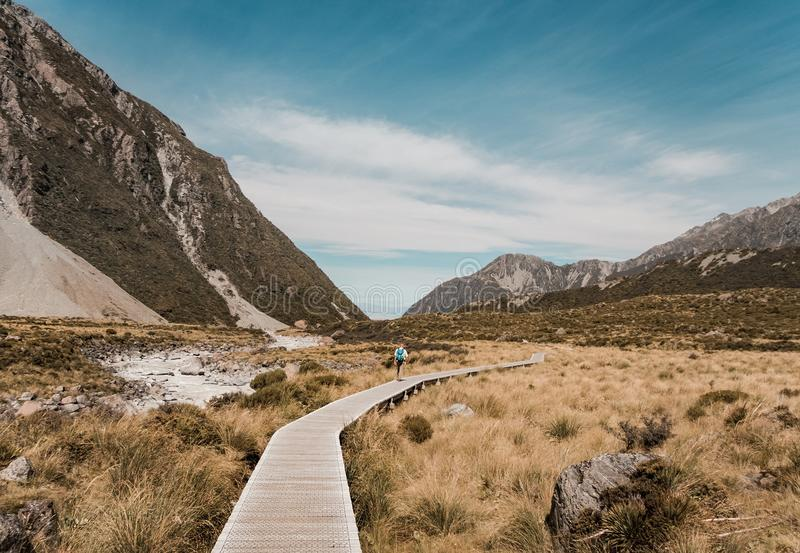 Wooden pathway in the mountain terrain. stock image