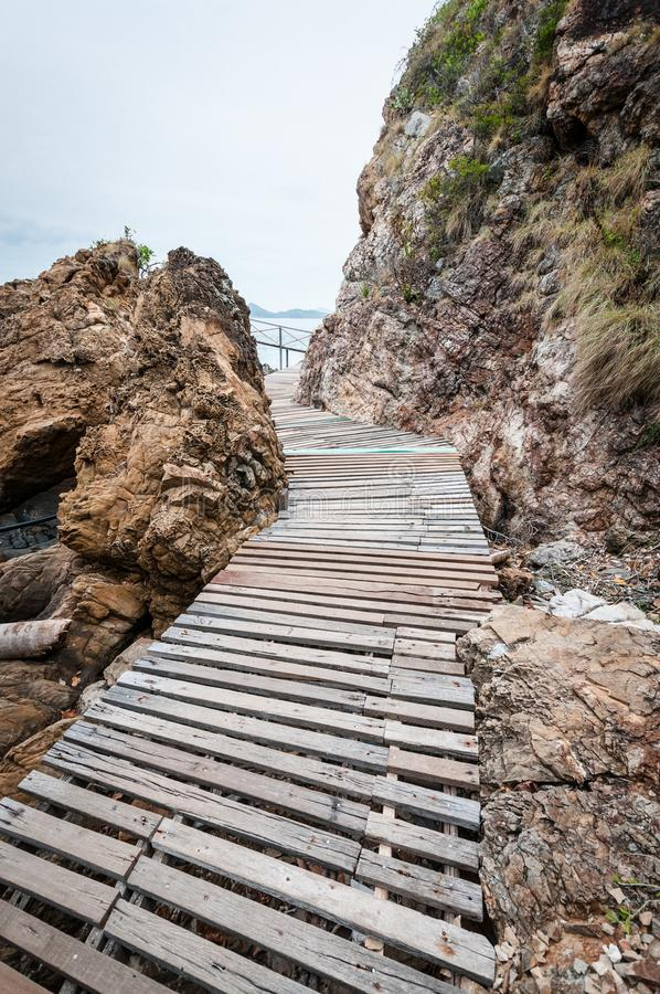 Wooden pathway with rock valley or cliff on the island stock images
