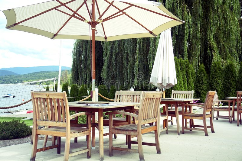 Wooden Patio Tables royalty free stock photos