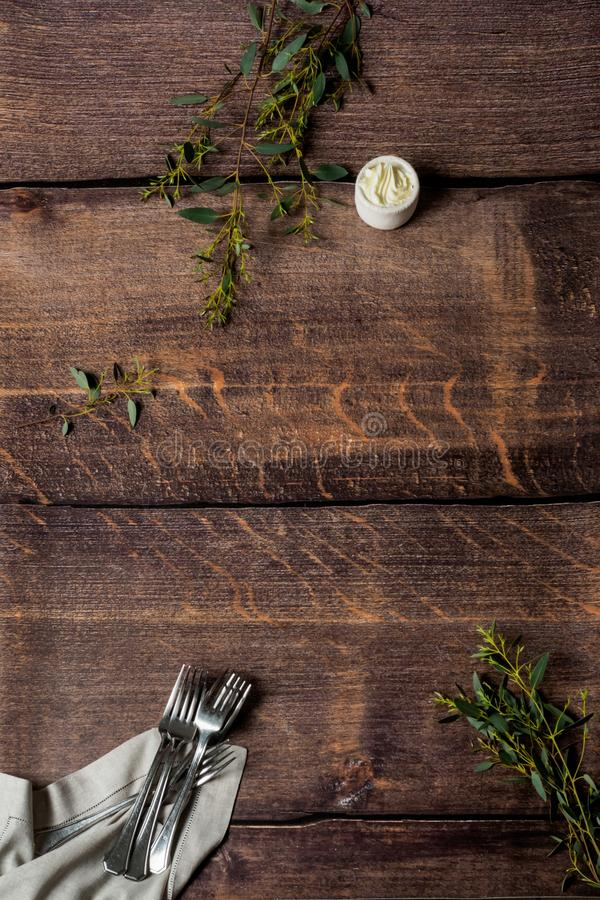 Wooden pattern with forks and butter stock photography