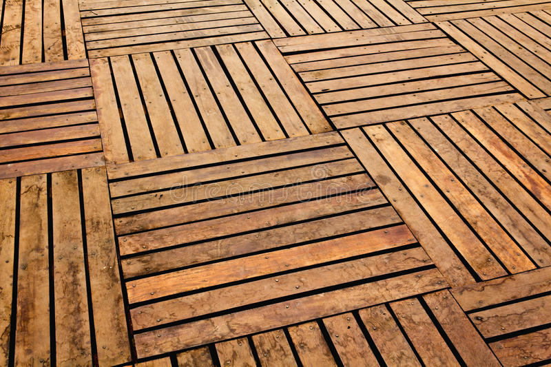 Wooden pavement. Patterns and textures of a wooden planks pavement stock images
