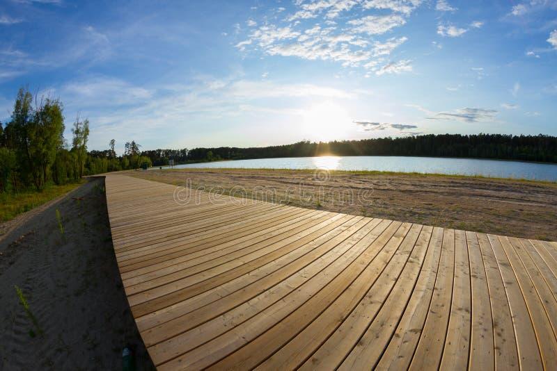 Wooden pavement on lake coast. Fisheye lens royalty free stock photography