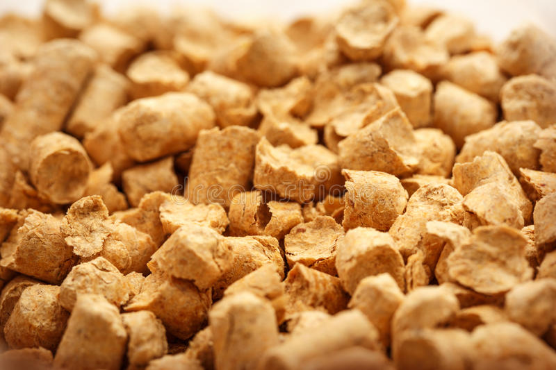 Wooden pellets for cat's toilet royalty free stock images